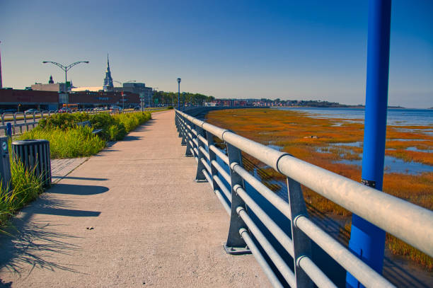 The pedestrian sidewalk that runs along the St. Lawrence River. stock photo