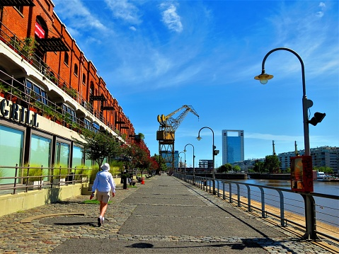 The pedestrian walkway at the Puerto Madero waterfront. Buenos Aires cityscape.