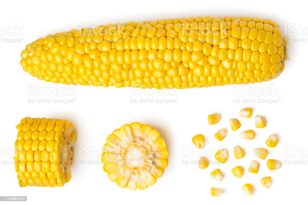 The peeled ear of corn, a piece of and seeds on a white, isolated. The view from the top. - Royalty-free Agricultura Foto de stock