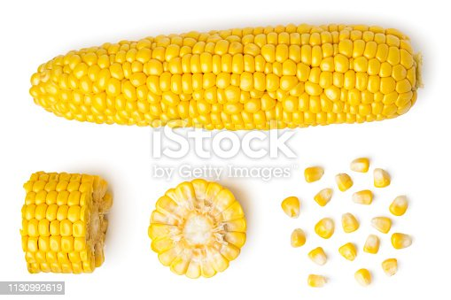 The peeled ear of corn, a piece of and seeds on a white background, isolated. The view from the top.