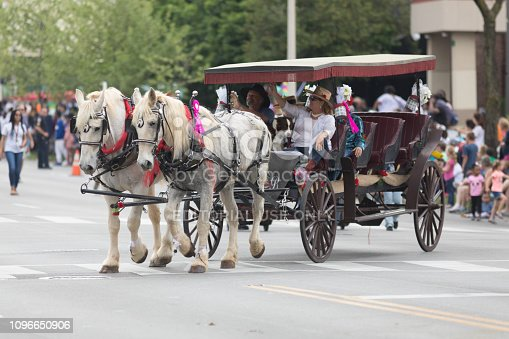 Louisville, Kentucky, USA - May 03, 2018: The Pegasus Parade, Man and woman riding a carriage pulled by horses down W Broadway