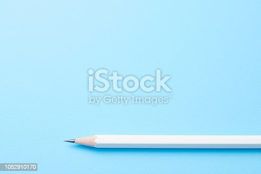 istock the pencil on blue 1052910170