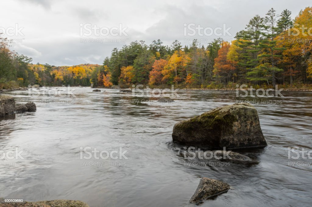 The Penobscot River Flows Around Large Boulders stock photo