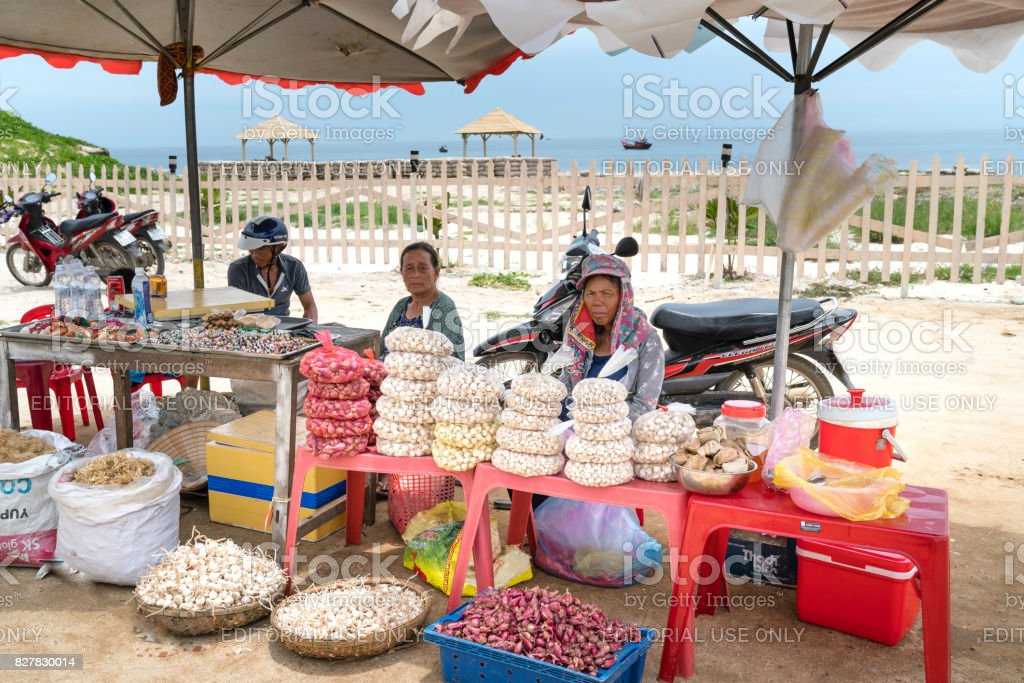 The people on Ly Son Island sell onion, garlic, and seaweed for tourists stock photo