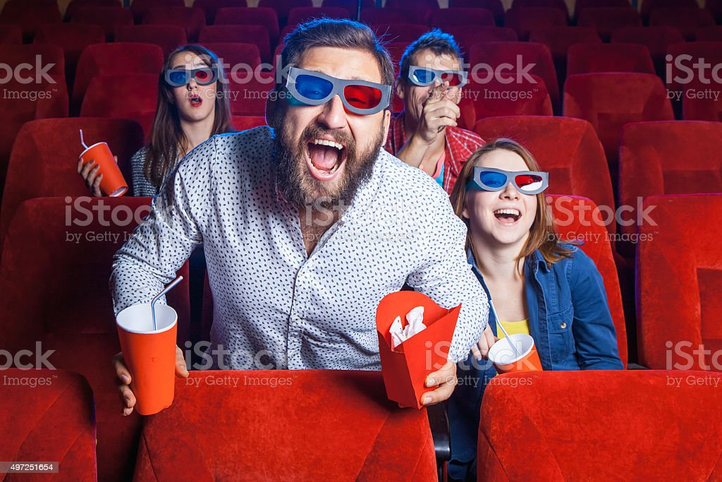 The people's emotions in the cinema stock photo