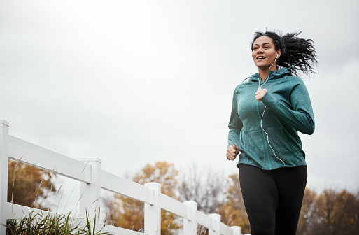 Shot of an attractive young woman going for a run in nature