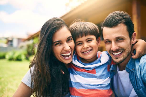 the perfect little family - couple portrait caucasian foto e immagini stock