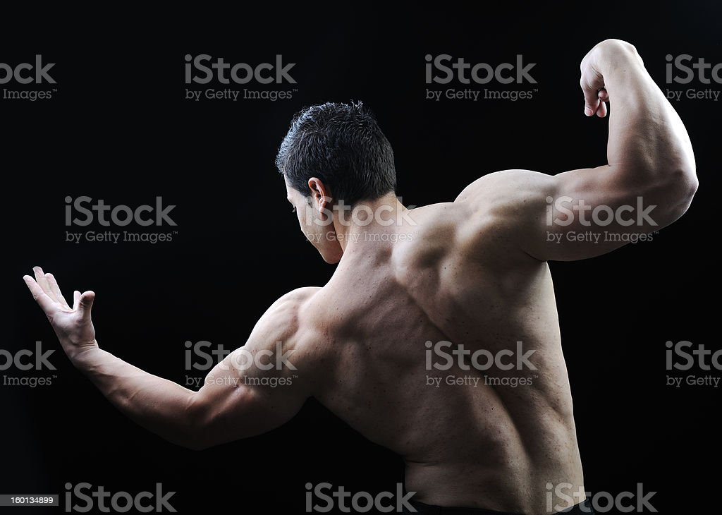The Perfect male body - Awesome bodybuilder posing royalty-free stock photo