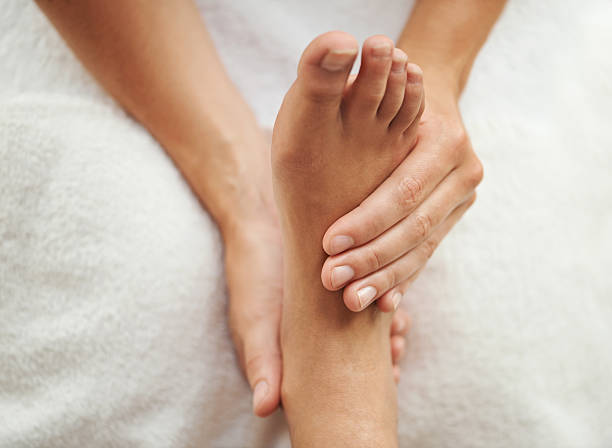 The perfect pedicure Cropped shot of a woman's foot being massagedhttp://195.154.178.81/DATA/shoots/ic_783326.jpg foot massage stock pictures, royalty-free photos & images