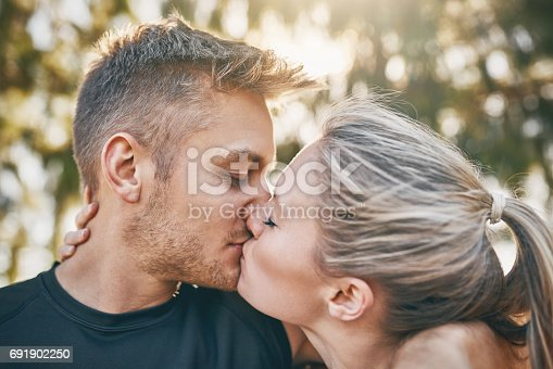 Shot of a young couple kissing outdoors