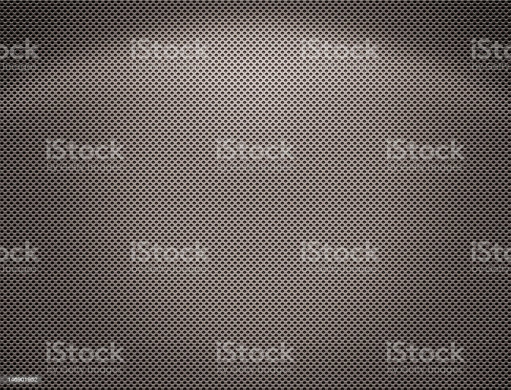 The Perforated silvery metal plate royalty-free stock photo