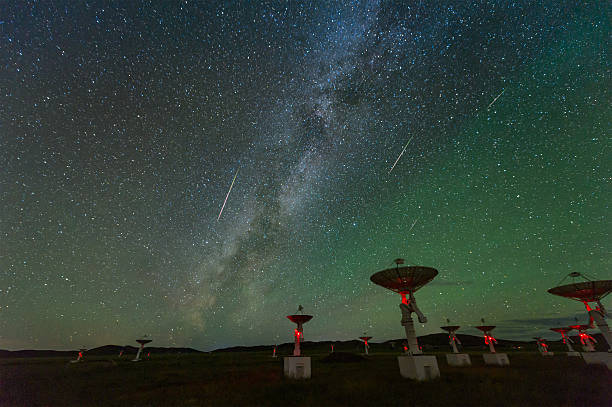 The Perseid meteor shower over the satellite receiving station stock photo