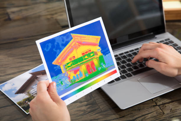 the person detecting heat loss of a house using laptop - defection stock photos and pictures