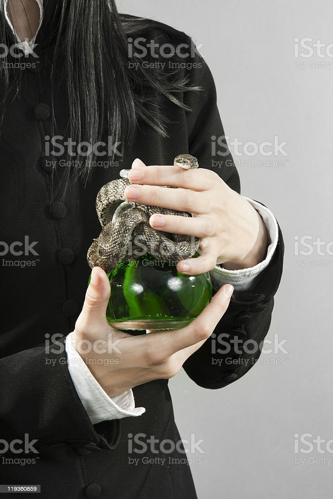 The person hold poison with a snake stock photo