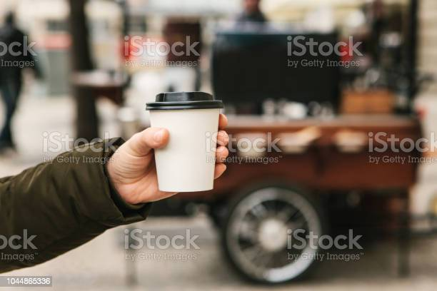 The person is holding a disposable glass in his hand with coffee or picture id1044865336?b=1&k=6&m=1044865336&s=612x612&h=fzyxagytwv5wqbnmhcn8ym2puzjgdl90hytuf8vkayc=