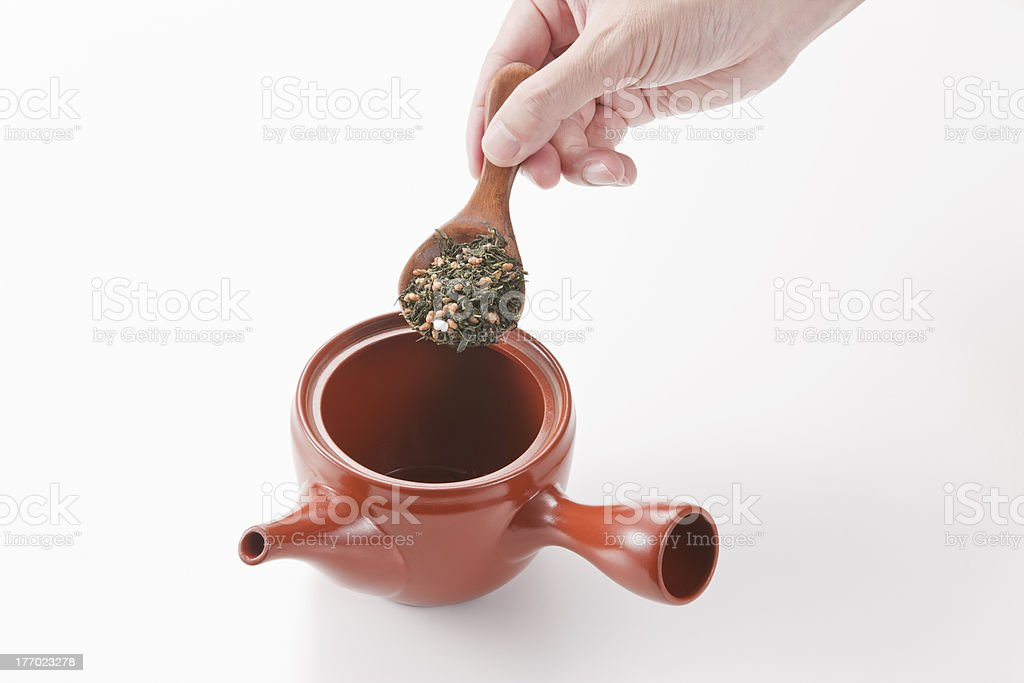The person who puts a tea leaf royalty-free stock photo