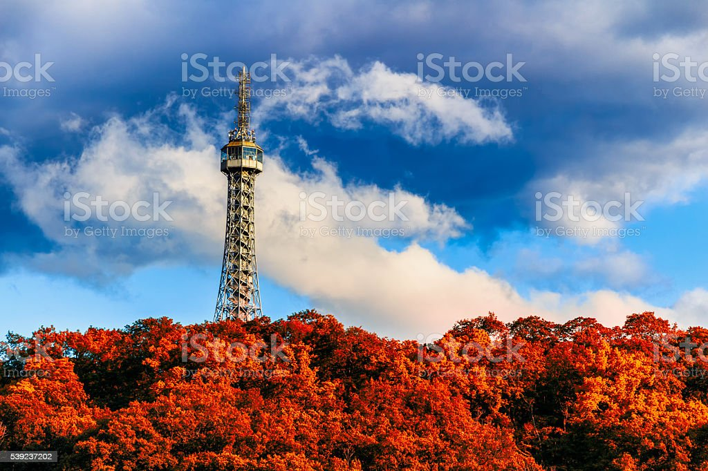 The Petrin observation tower in Prague with red foliage royalty-free stock photo
