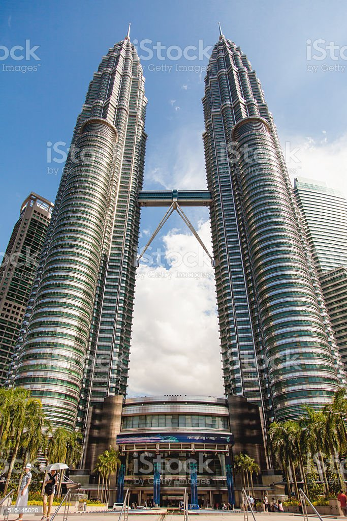 The Petronas Twin Towers on sky background in sunny day. stock photo