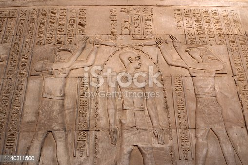 178769498 istock photo The Pharaon gets power from the Gods 1140311500