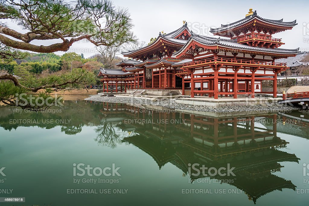 The Phoenix Hall reflect on water, Byodo-in Temple stock photo