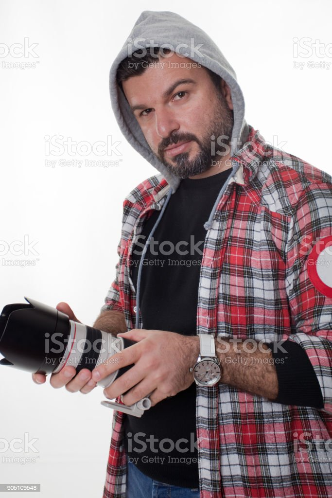 The photographer is preparing for the studio shoot stock photo