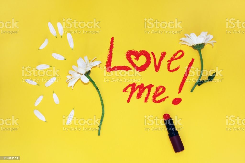 The phrase: love me , written by lipstick stock photo