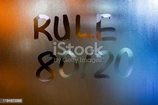istock the phrase rule 80 by 20 - pareto principle - handwritten on classic blue night wet window glass with selective focus 1194920385