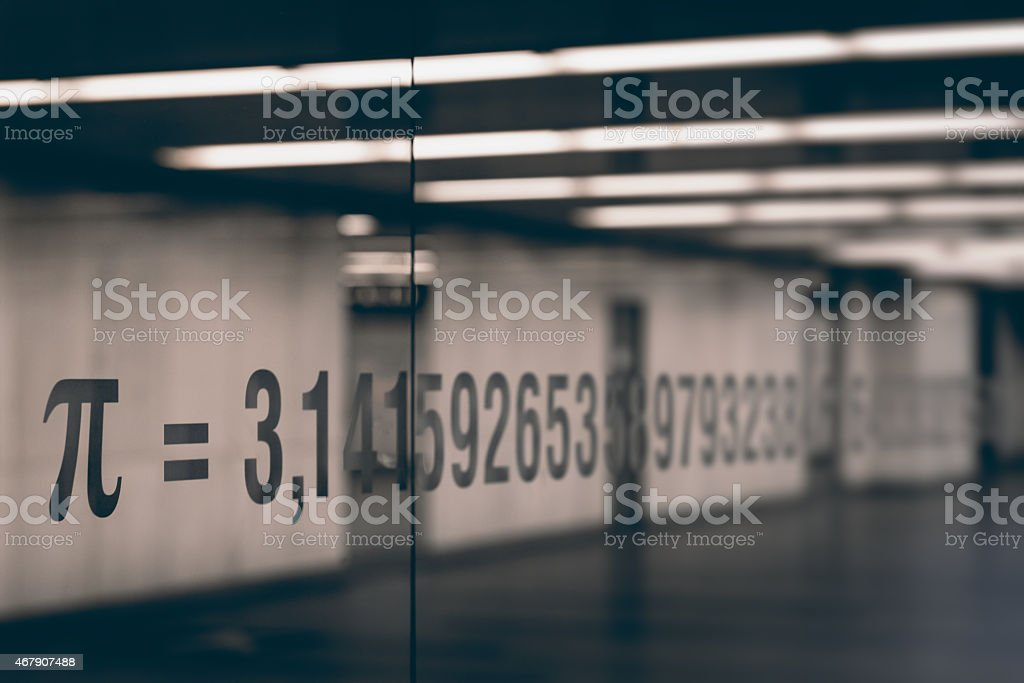the pi symbol and numbers of mathematical constant on glass stock photo