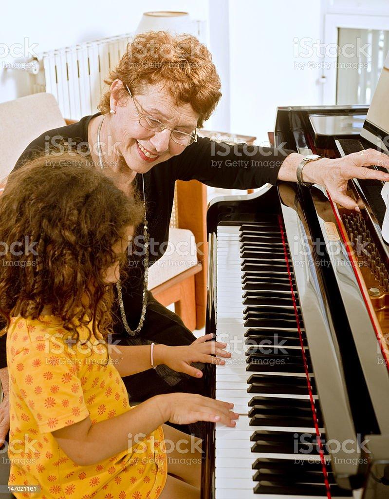 the piano teacher royalty-free stock photo