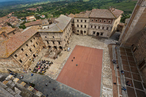 The Piazza Grande of Montepulciano with its Cathedral in Tuscany, Italy The Piazza Grande in the hill town of Montepulciano in Tuscany Italy. The Birdseye view from its town tower. piazza grande stock pictures, royalty-free photos & images