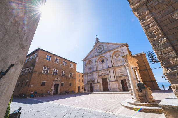 The piazza the town of Pienza in Tuscany, Italy. A popular tourist destination in Tuscany, Italy. stock photo