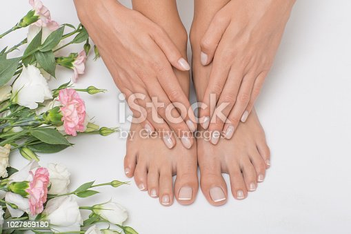938027870 istock photo The picture of ideal done manicure and pedicure. 1027859180