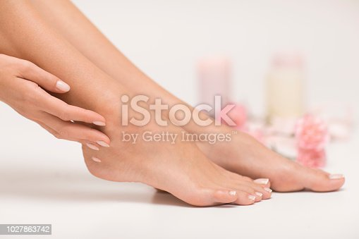 938027870 istock photo The picture of ideal done manicure and pedicure. 1027863742
