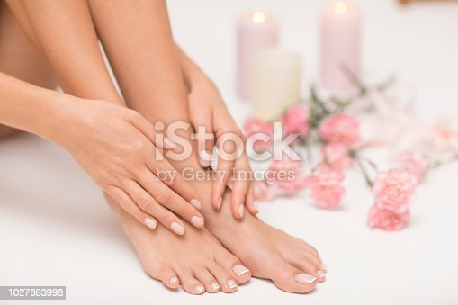 938027870 istock photo The picture of ideal done manicure and pedicure. 1027863998