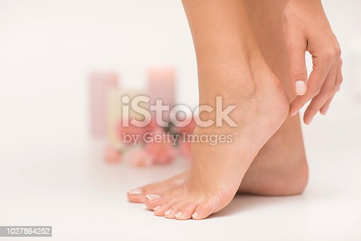 938027870 istock photo The picture of ideal done manicure and pedicure. 1027864252