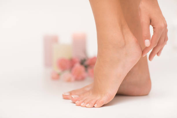 The picture of ideal done manicure and pedicure. Female hands and legs in the spa spot. human foot stock pictures, royalty-free photos & images