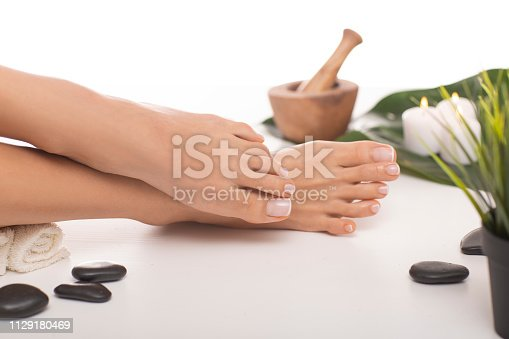 938027870 istock photo The picture of ideal done manicure and pedicure. 1129180469