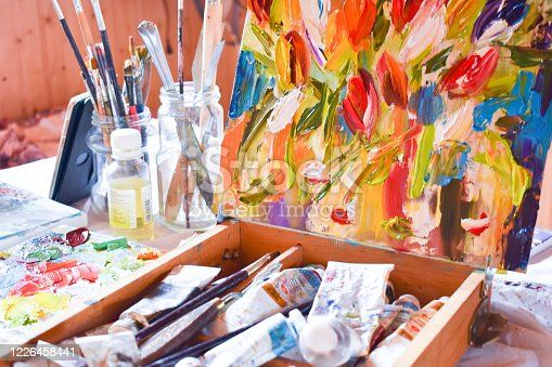 artist's Studio. Drawing an oil painting. Desk with paints and brushes. Canvas painting on the easel.