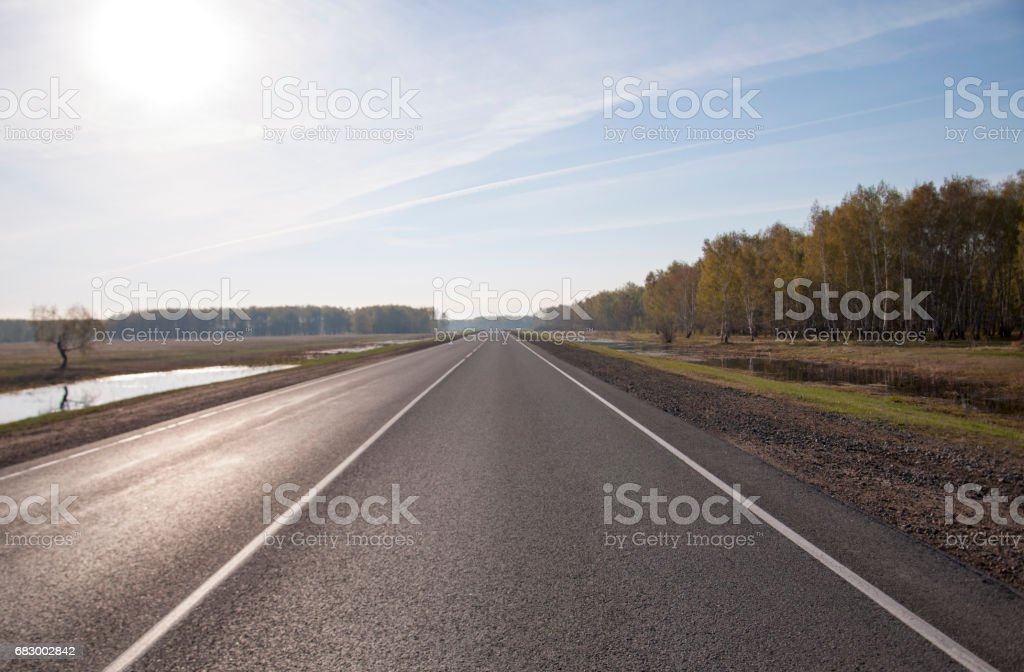 The picturesque landscape and the Sunrise over the road. royalty-free stock photo
