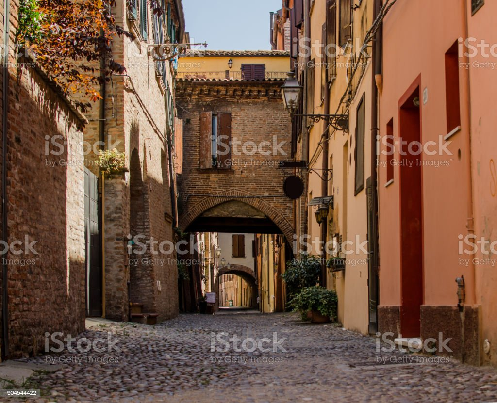 The picturesque  medieval street of Ferrara, Italy stock photo