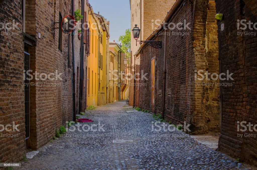 The picturesque  medieval street of Ferrara stock photo