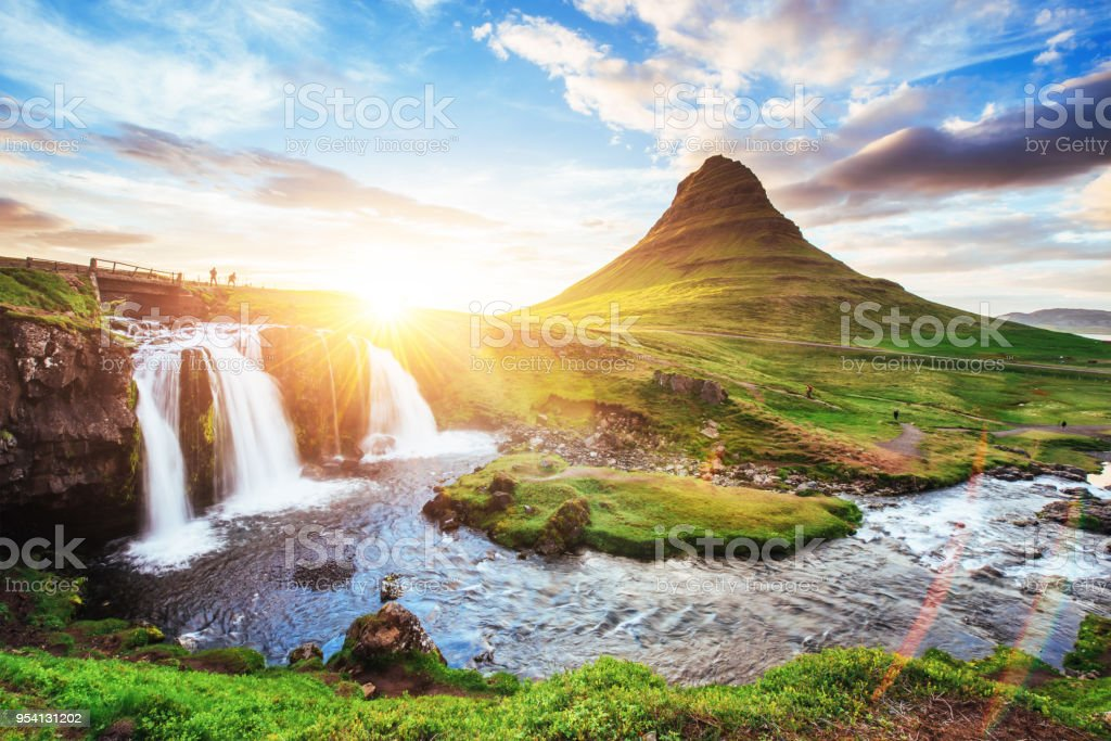 The picturesque sunset over landscapes and waterfalls. Kirkjufell mountain, Iceland stock photo