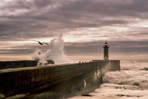 the pier on stormy day - rain clouds porto portugal imagens e fotografias de stock