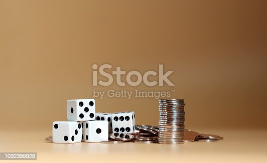 istock The pile of coins and dice. 1032395928