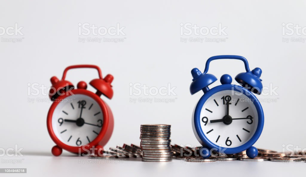 The pile of coins between two alarm clocks.