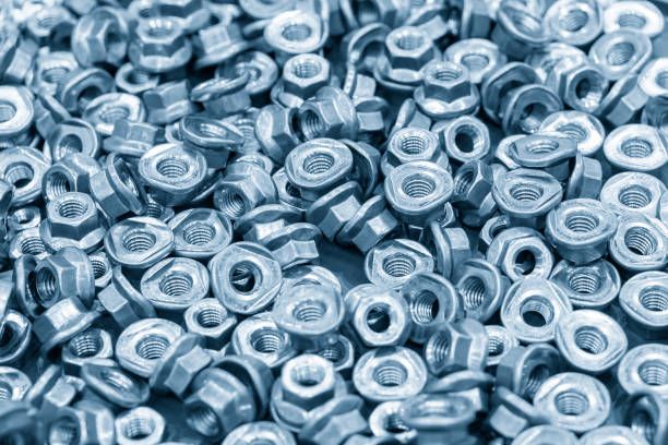 The pile of custom hexagon nut for special purpose in the light blue scene. The pile of custom hexagon nut for special purpose in the light blue scene.The industrial corrosion free nut and bolt manufacturing concept. washer fastener stock pictures, royalty-free photos & images