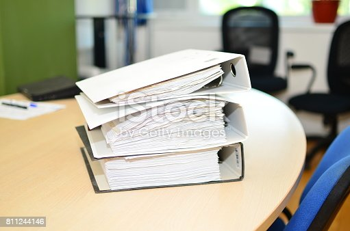 istock The pile of file binder with papers 811244146