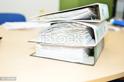 istock The pile of file binder with papers 811250550