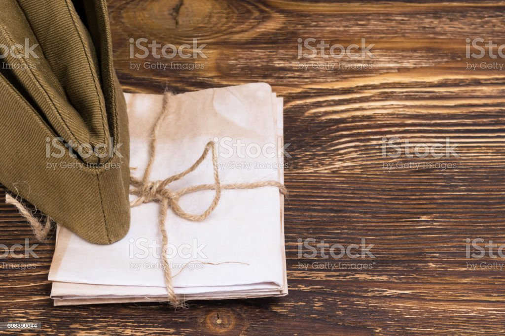 the pile of letters under the old military cap , place the graphic on the right stock photo