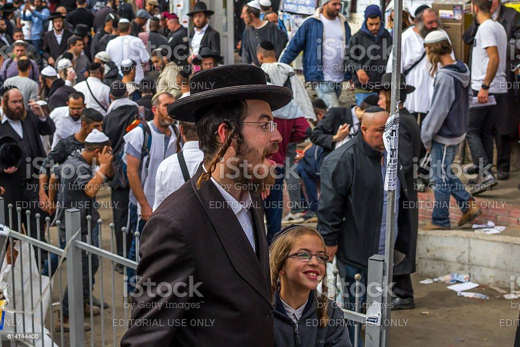 The pilgrims Hasidim Jews at the grave of Rabbi Nachman. stock photo